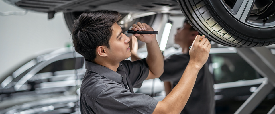 Mechanic inspects a car for possible product liability.