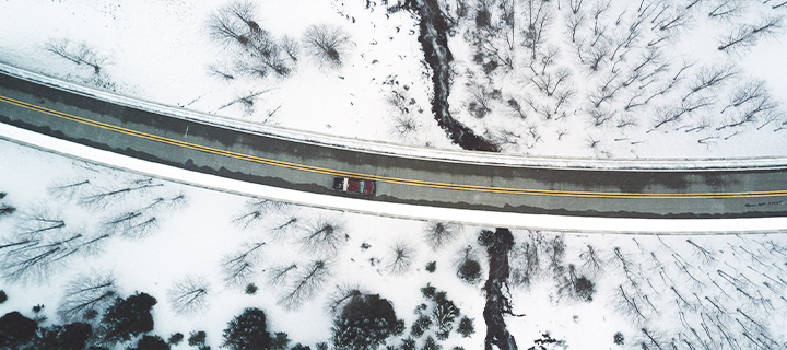 Car driving on windy road in the winter. the winter
