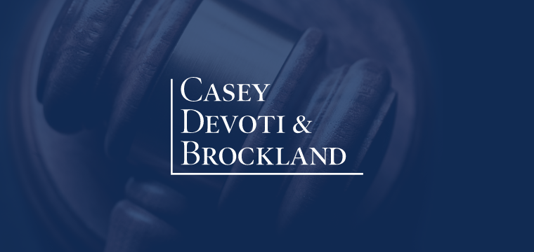 Casey Devoti & Brockland logo over a gavel in personal injury case
